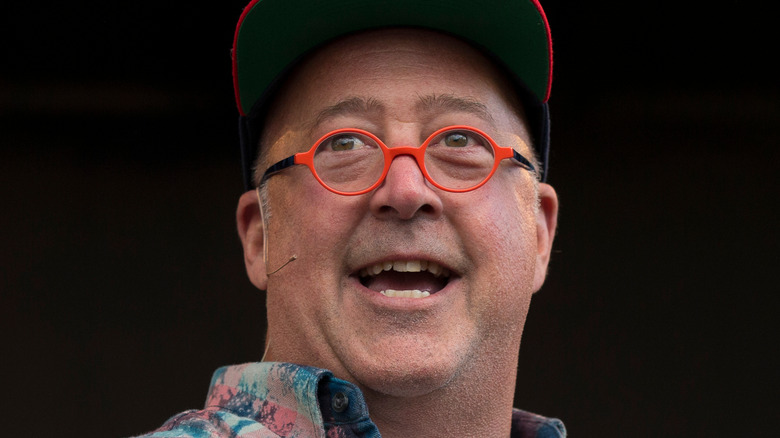 Andrew Zimmern talking and smiling