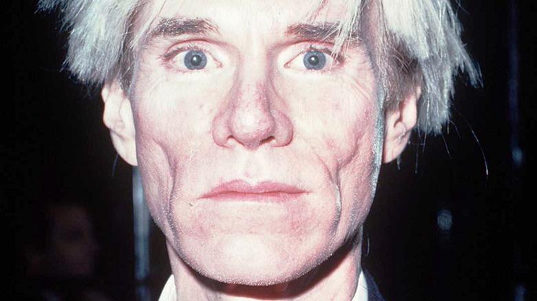 Andy Warhol staring into camera