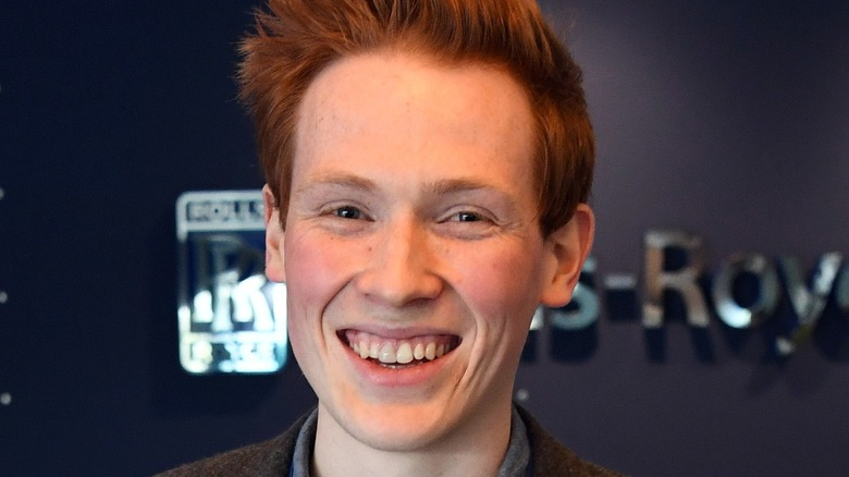 andrew smyth smiles with hair spiked up