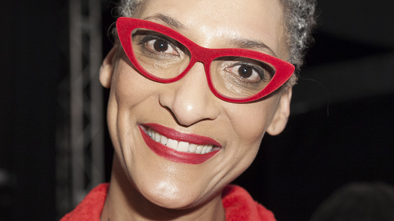 Carla Hall wearing red glasses