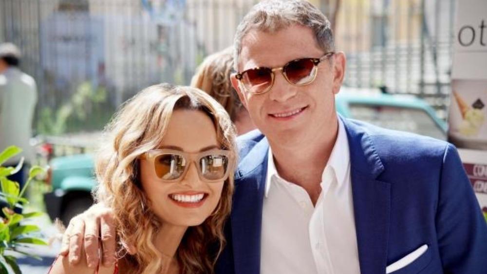 Bobby and Giada smiling, wearing sunglasses