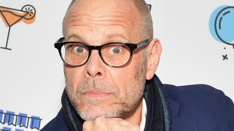 Alton Brown with chin on hand