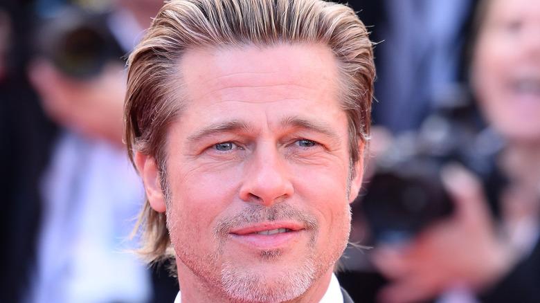 Brad Pitt attends a premiere