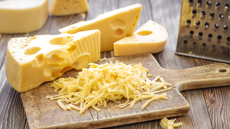 Swiss cheese on cutting board, grated