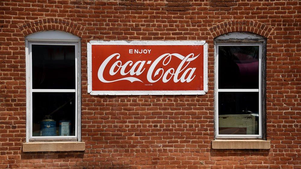 Coca-Cola sign on brick building
