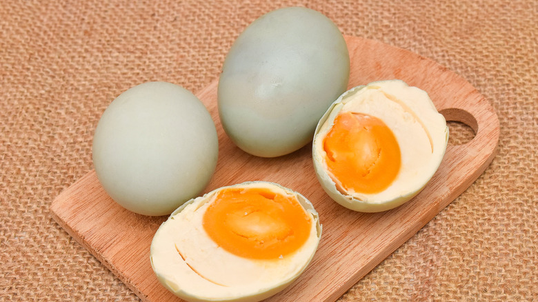 Salted duck eggs on a wood board