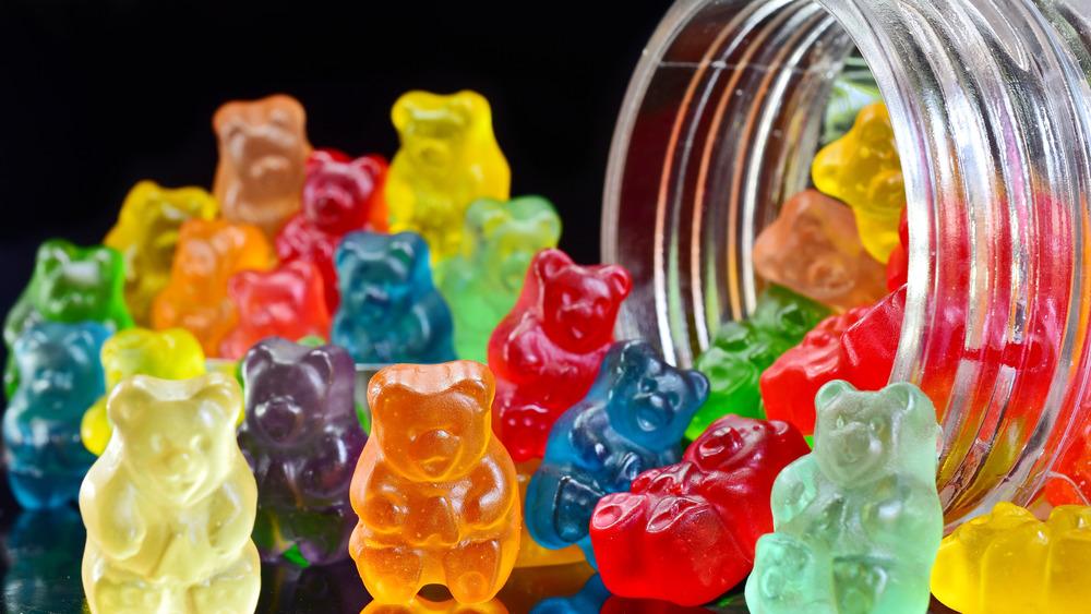 Gummy bears spilled out of a mason jar