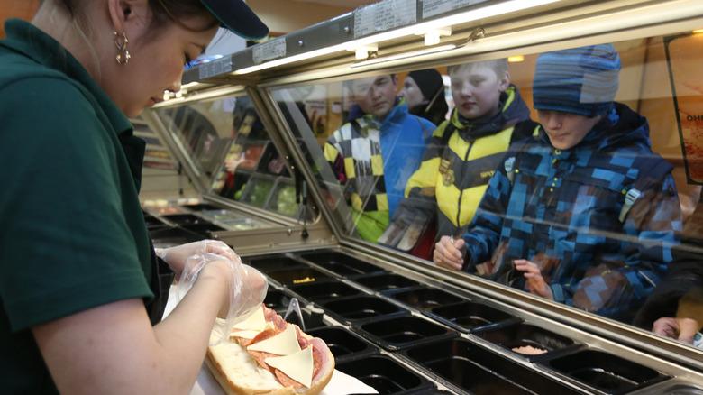 Subway worker making sandwich