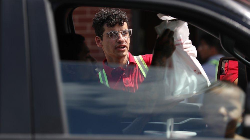 car in Chick-fil-A drive-thru with a child