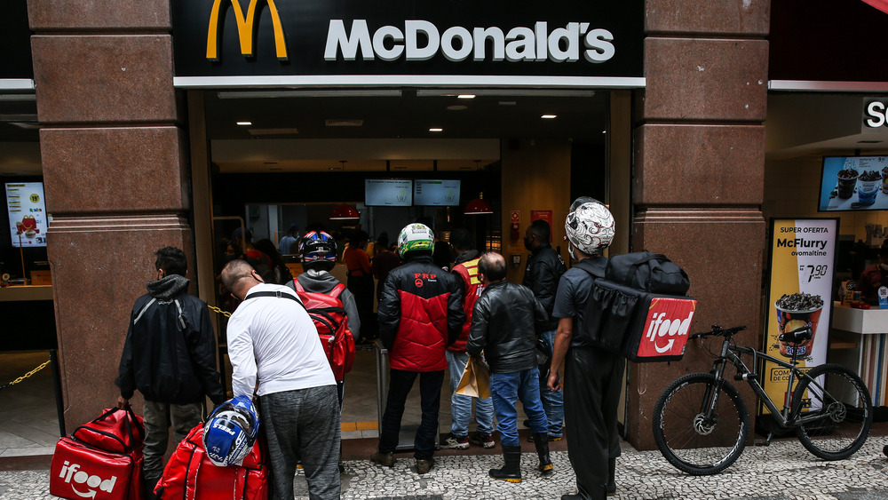 McDonald's storefront with a crowd waiting to get in