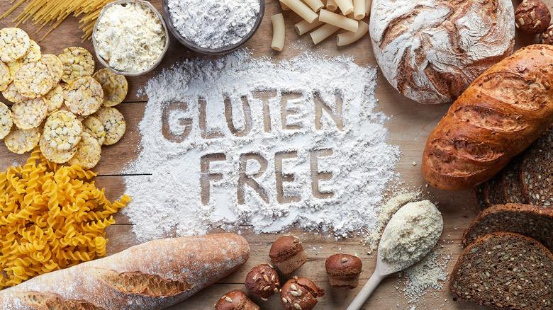 Breads and pastas arranged around the words 'gluten free' written in flour