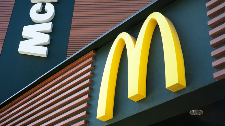 McDonald's golden arch sign on building