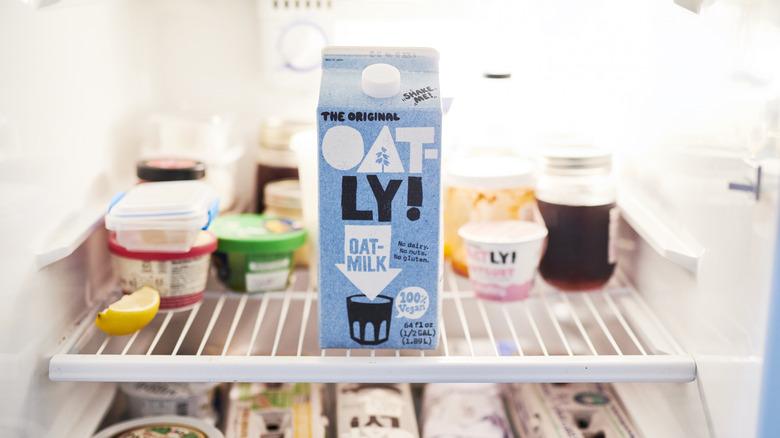 Carton of Oatly milk on refrigerator shelf