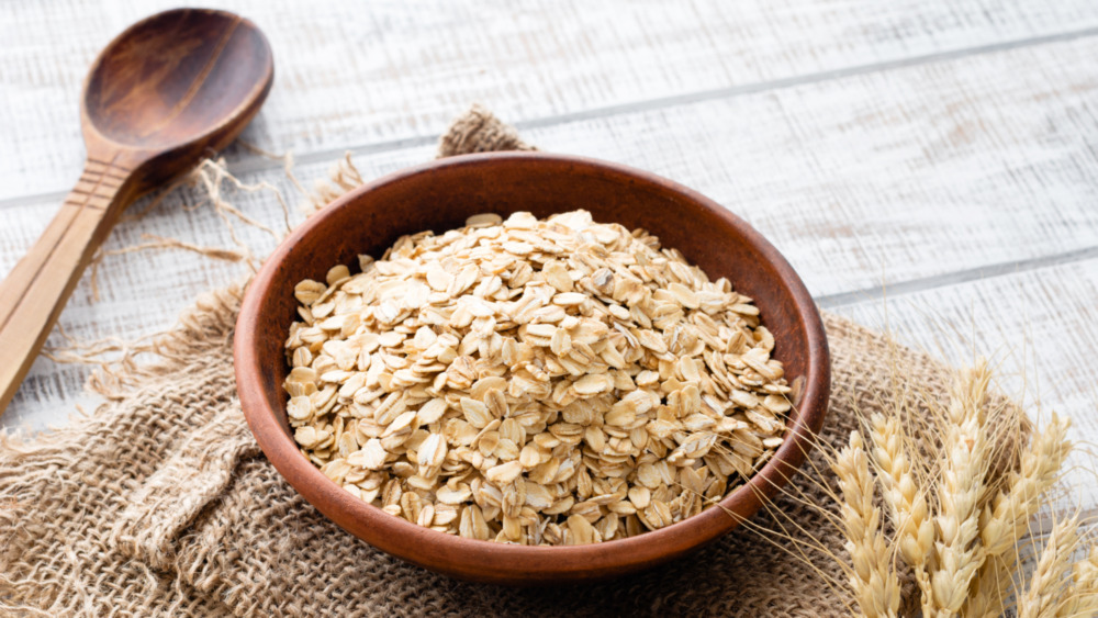 Wooden bowl filled with rolled oats