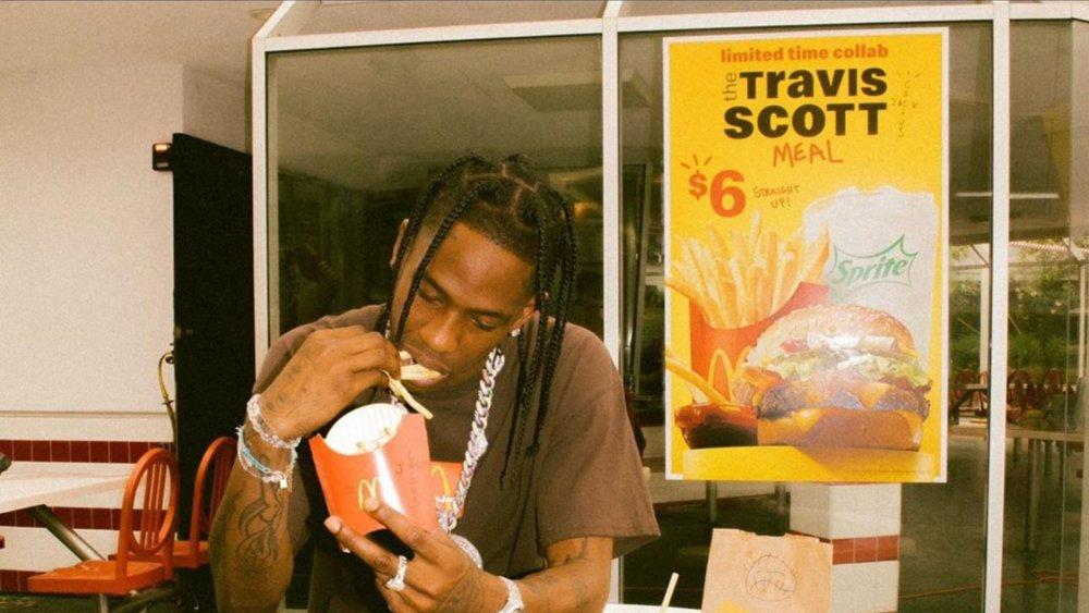Travis Scott poster on McDonald's window