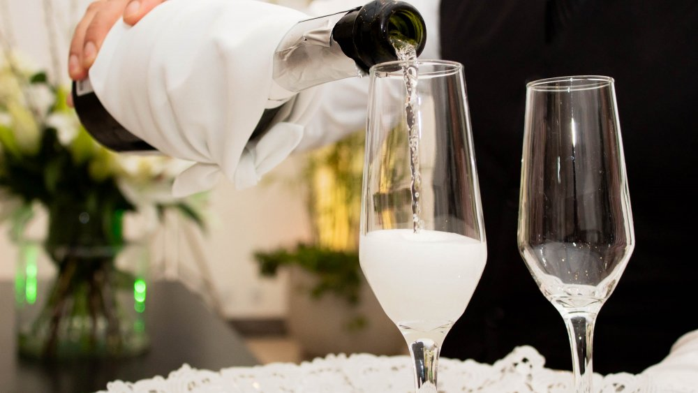 Champagne being poured into glasses