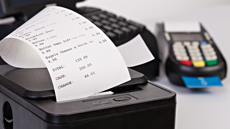 A receipt coming out of a black machine