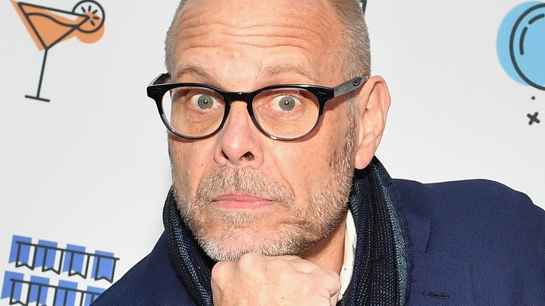Alton Brown with black glasses on
