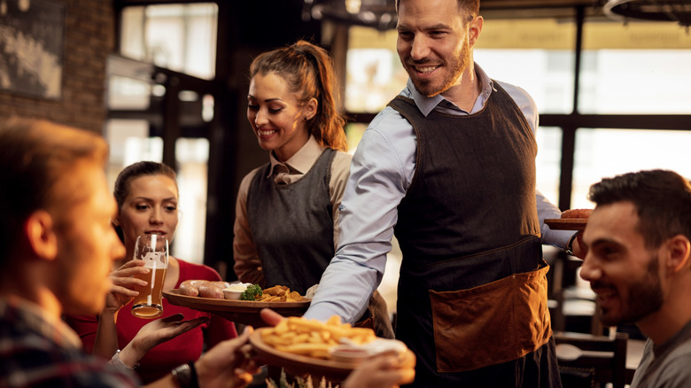 Waiters serving a restaurant table