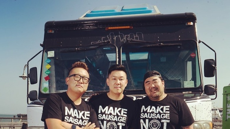 Seoul Sausage team standing in front of food truck