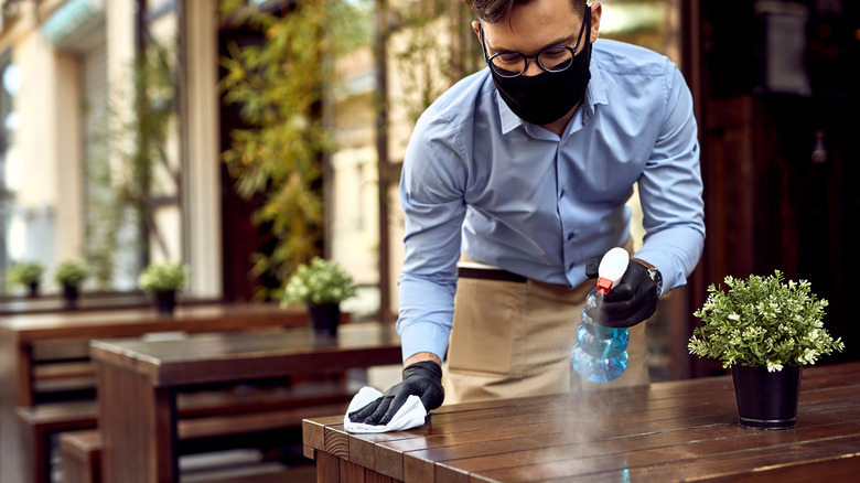Cleaning off a restaurant table