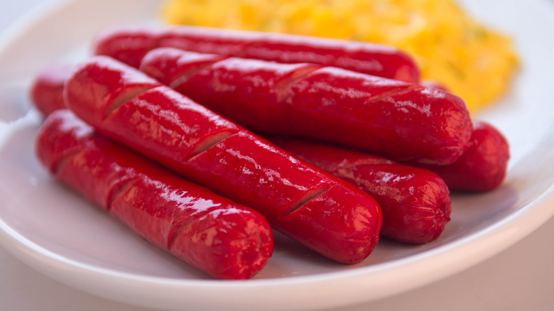 Plate of red hot dogs