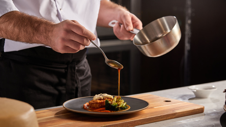 Chef preparing dish