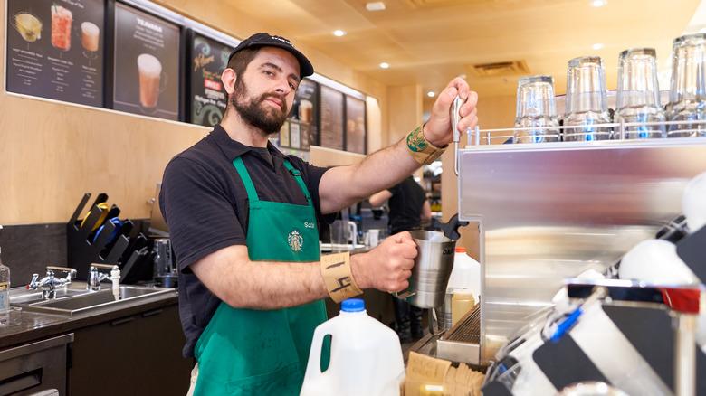 Starbucks barista steaming milk