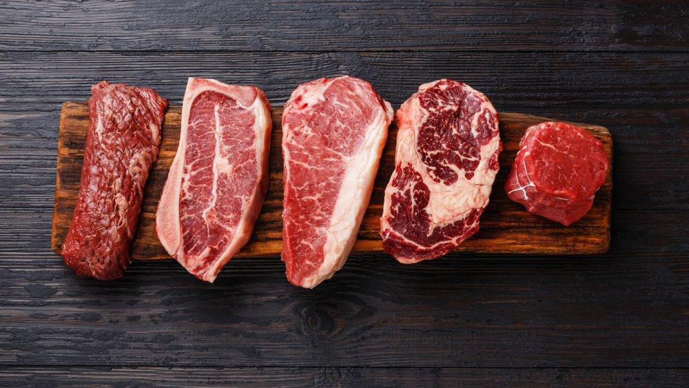 Steak cuts on a wooden board