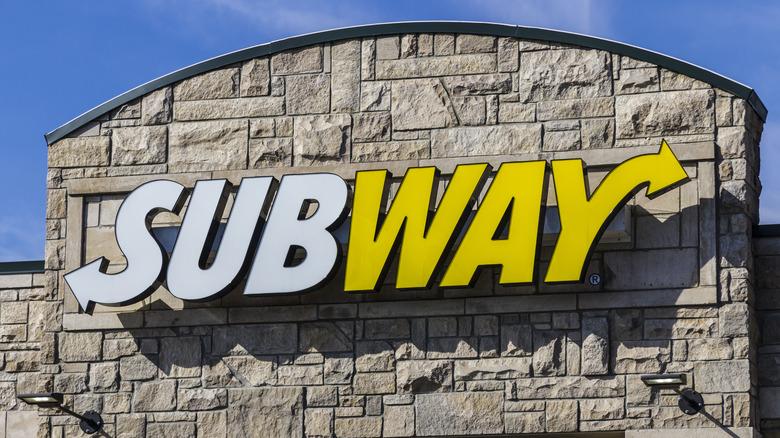 Subway sign on brick building