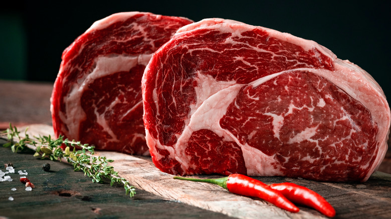 Two marbled steaks standing upright