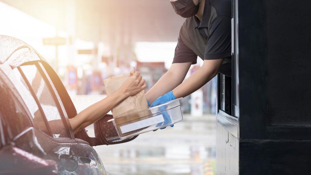 Employee handing over fast food order