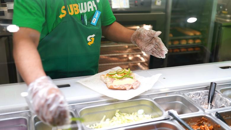 Subway employee making sandwich