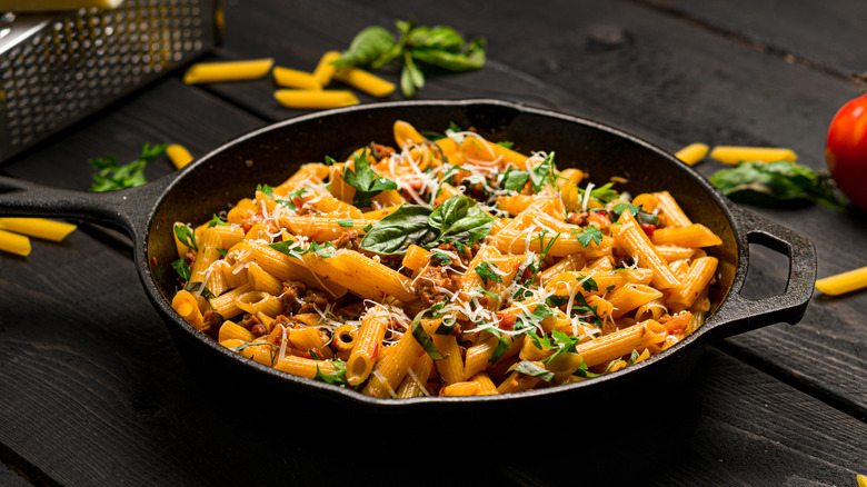 heating pasta in a skillet