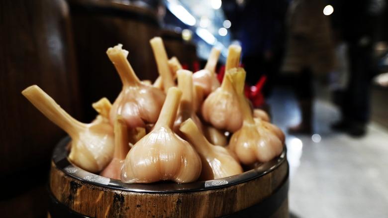 Pickled garlic in barrel
