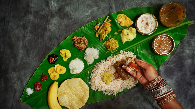 A woman eating South Indian food with her hand