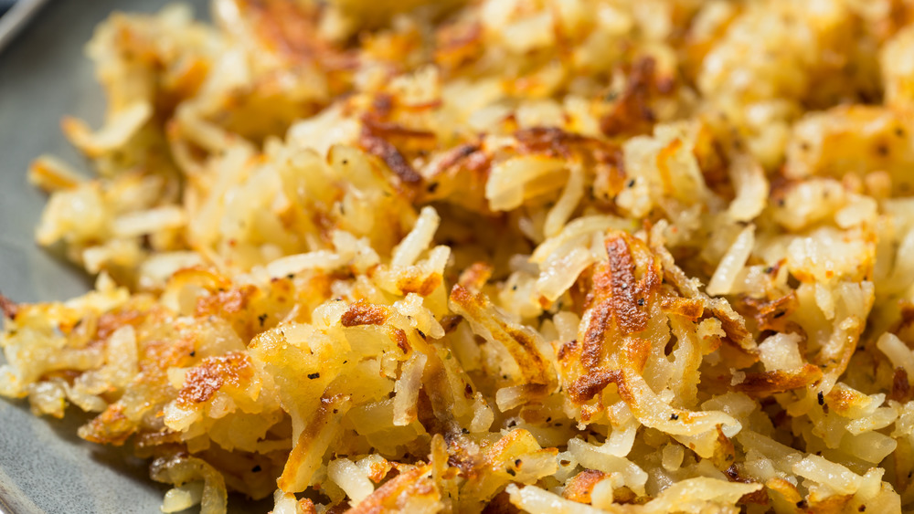Cooked hash browns in a pan