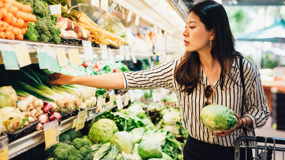 woman shopping produce section at grocery store