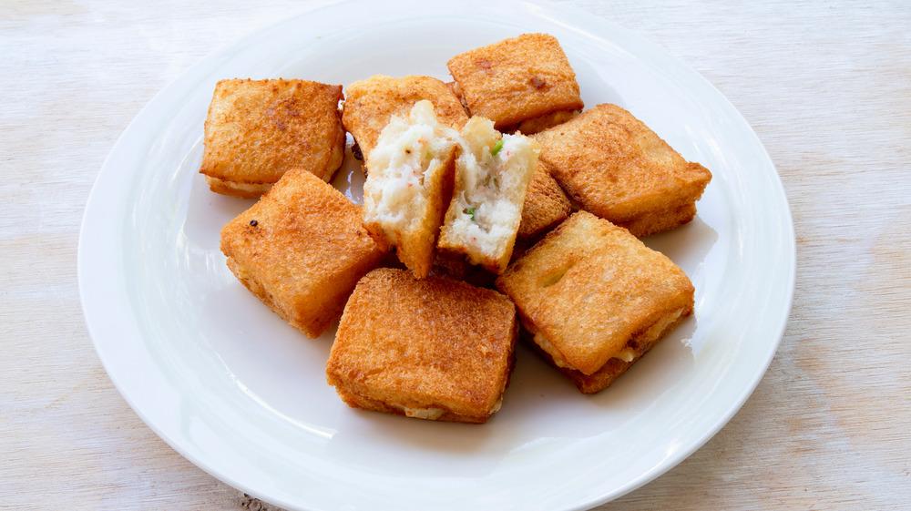 Square shrimp toast on white plate