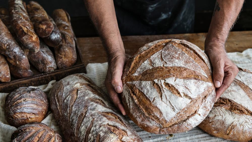 Hands holding homemade sourdough bread