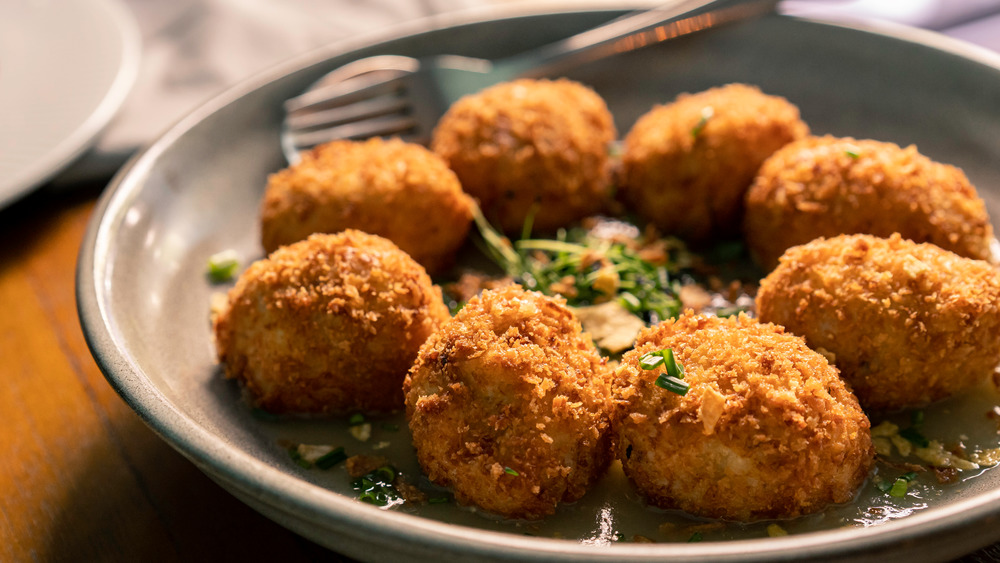Croquettes with sauce on plate