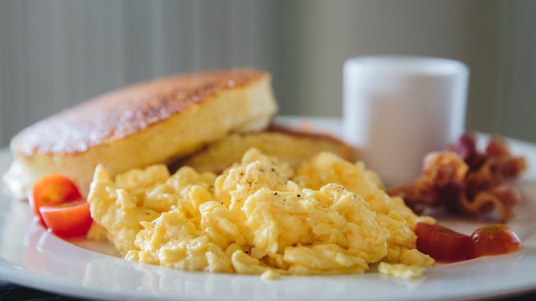 Scrambled eggs and pancakes