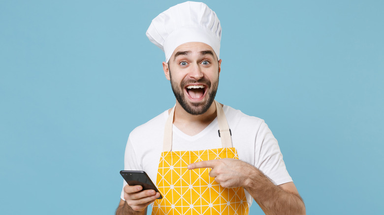 Chef holding a phone