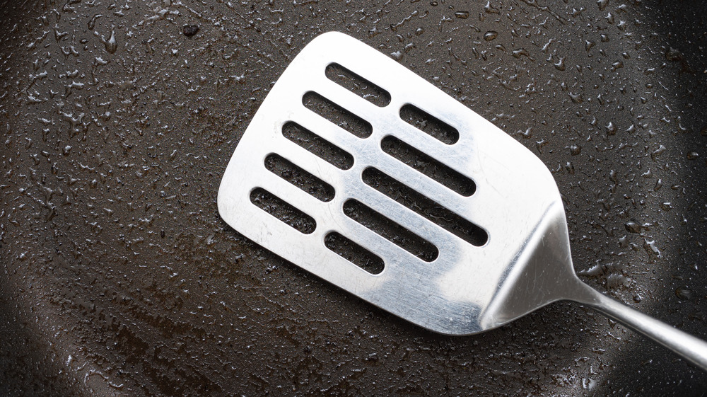 Spatula in oily pan