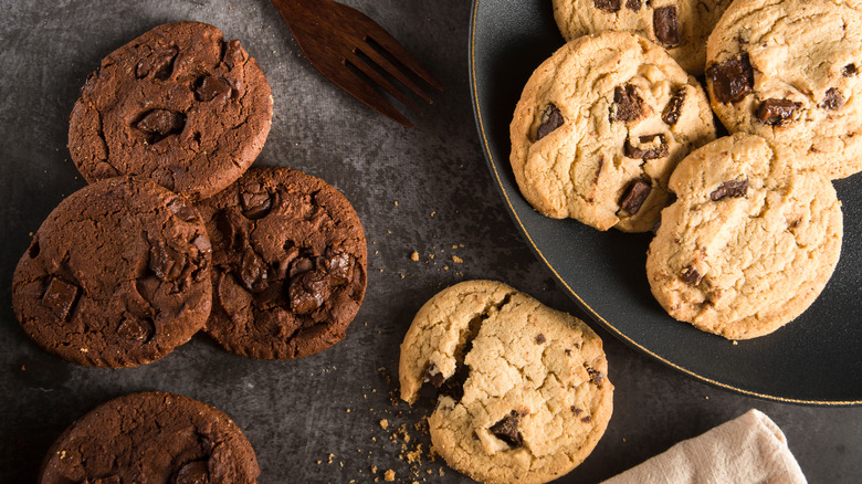 chocolate chip cookies on a countertop and plate