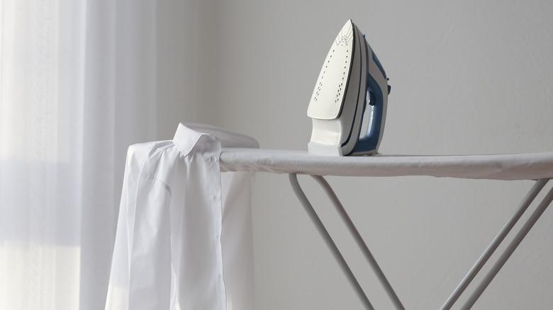 Shirt and iron sitting on ironing board