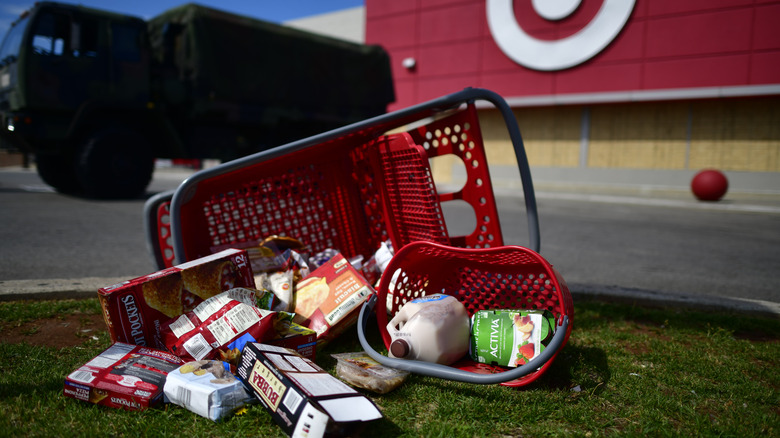 Groceries lie scattered on the ground in the aftermath of looting as members of the Pennsylvania National Guard monitor activity outside a shuttered Target store on June 3, 2020 in Philadelphia, Pennsylvania.