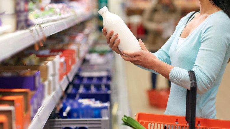 woman buying milk