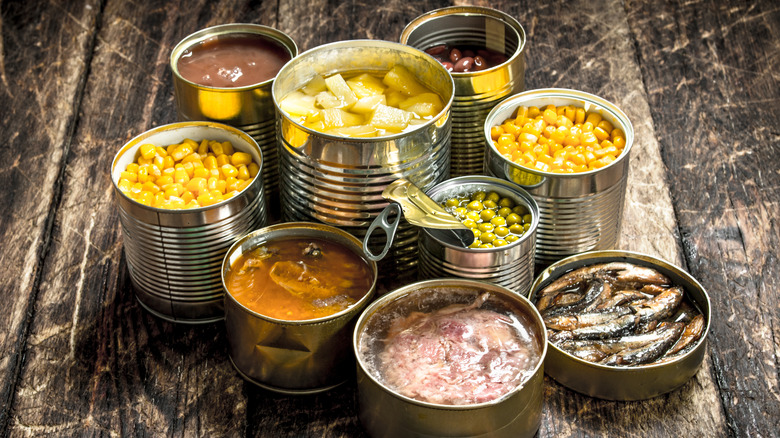 Canned foods on a wooden surface