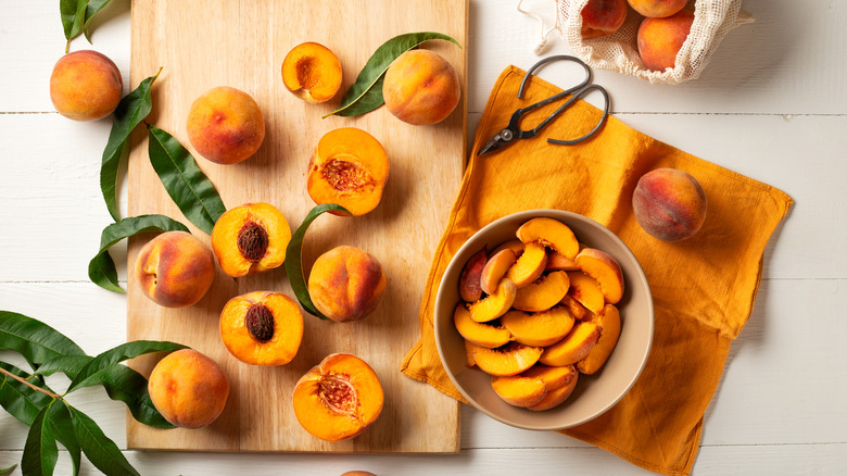 Cutting peaches and pits in kitchen